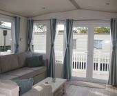 lounge with patio doors opening onto decking